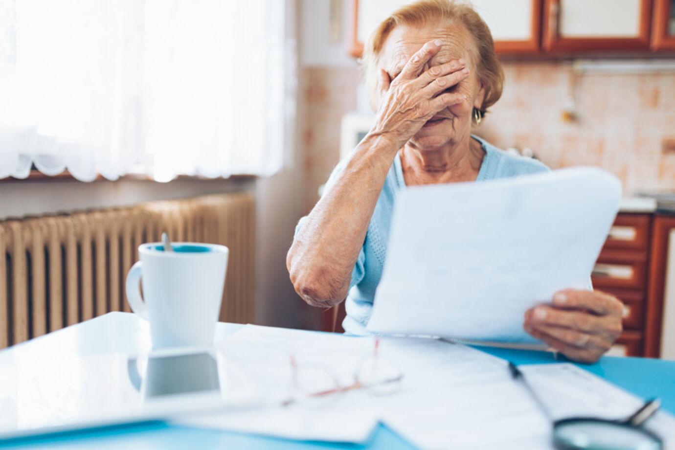 Elderlywomanlookingatherutilitybills